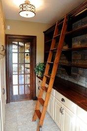 6-Inside pantry with ladder and stone backsplash