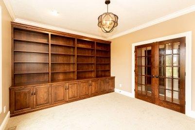 12-Knotty alder custom study cabinetry